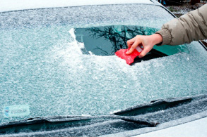 Scraping ice off a car window